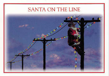 Santa stringing lights on telephone line Christmas Card
